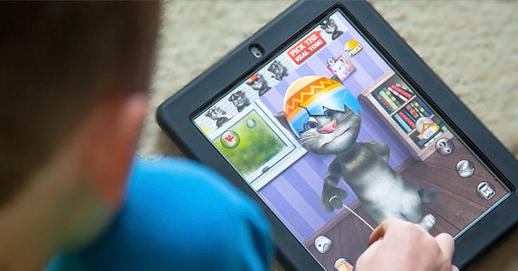 Boy using an app for people with disabilities on a tablet