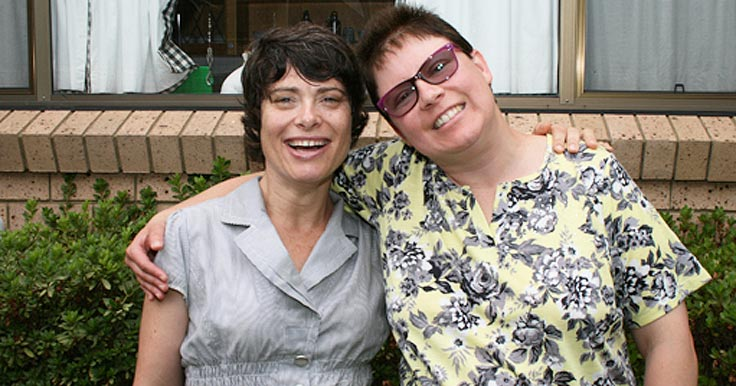 Peta and Nat outside their home