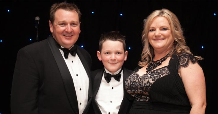 Amanda and Sean with their son Alex at an Aruma fundraising dinner