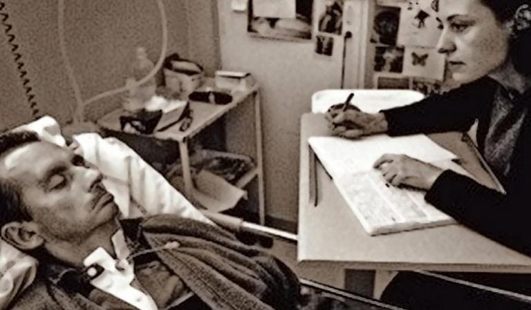 Jean Dominique Bauby in bed in the hospital writing his book by blinking
