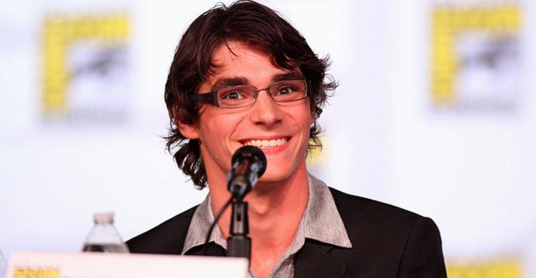 Actor RJ Mitte presenting with a microphone