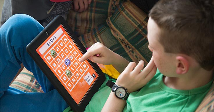 Boy with a disability using an iPad and an assistive technology app