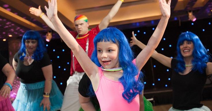 Zayla dancing in a blue wig