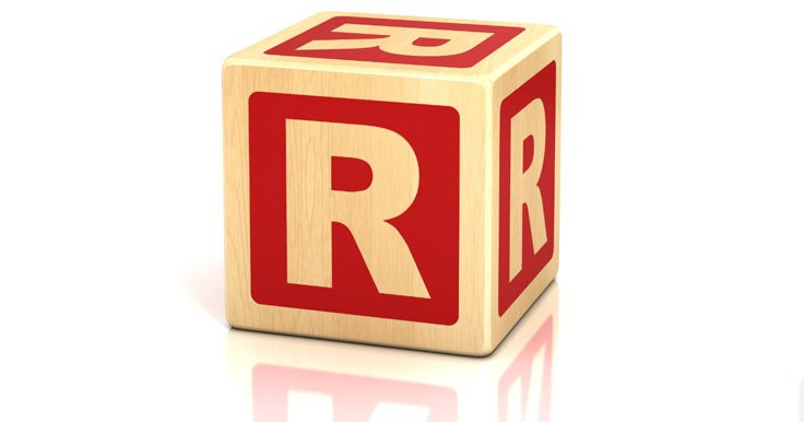 Wooden block with the letter R on it