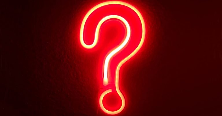 Neon question mark on a dark background