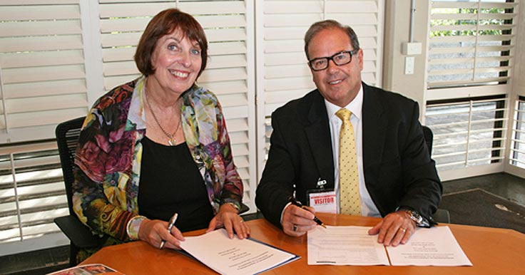 Head of Strategy, People & Practice, Lyn Ainsworth signing the partnership agreement with Blooms The Chemist CEO, Phil Smith.