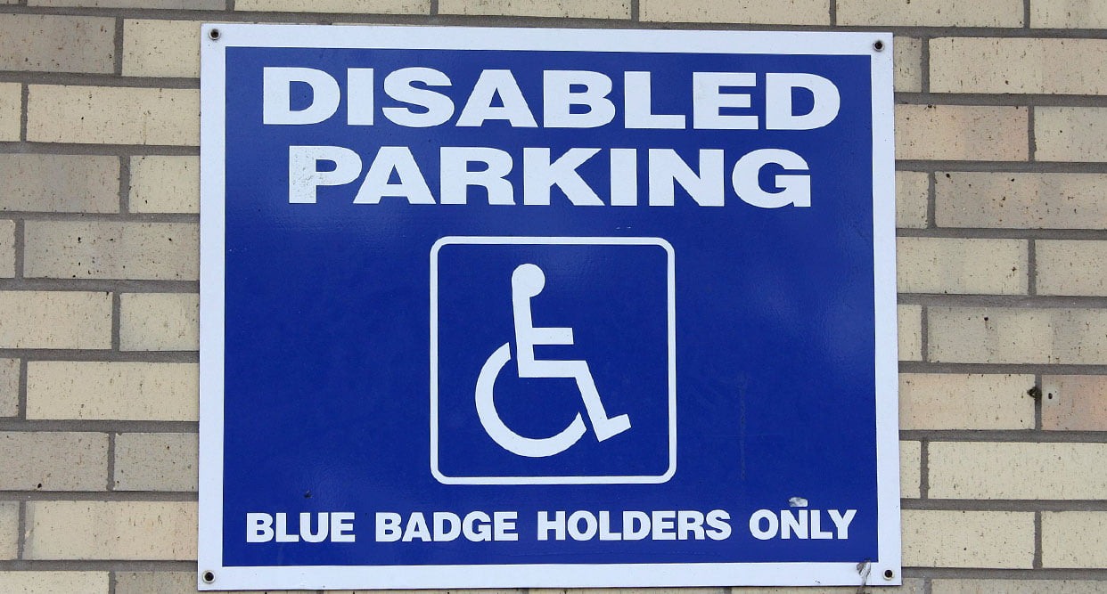 Brick wall with disabled parking sign