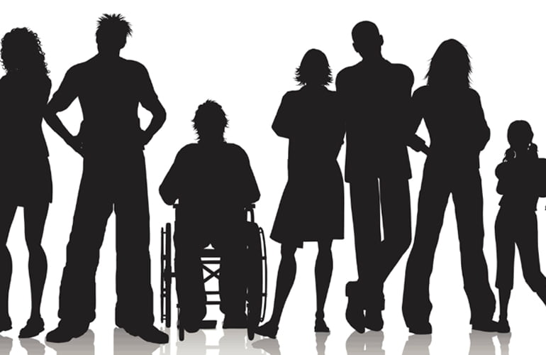 Group of people as silhouettes standing in a line