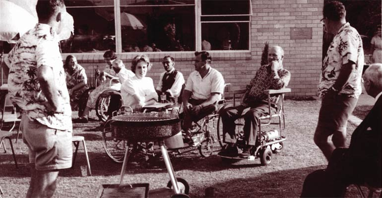 Group of people with a disability at a BBQ