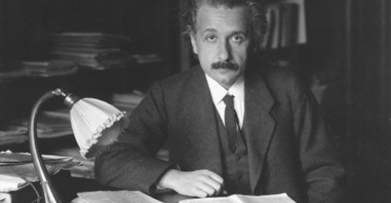 Einstein sitting in his study
