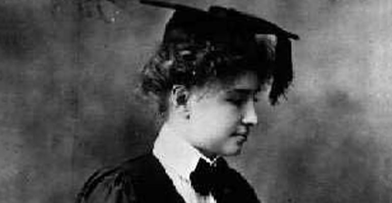Helen Keller wearing a graduation cap and robe