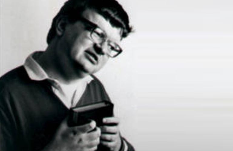 Kim Peek holding a book