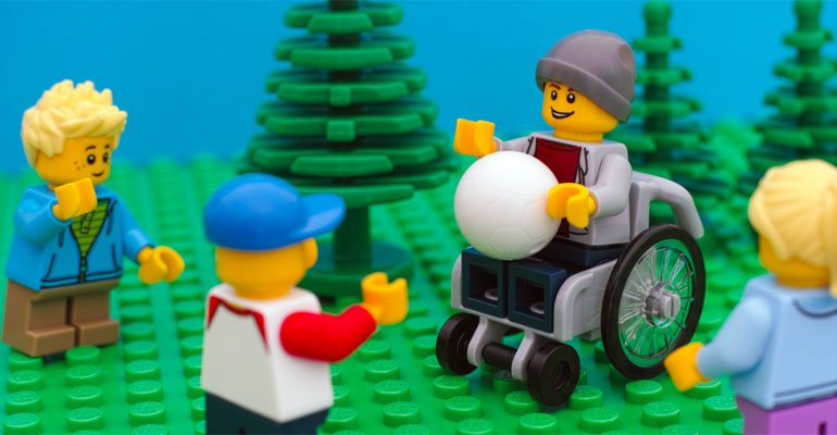 Lego figure of a boy in a wheelchair