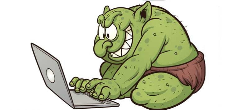 Cartoon troll typing on a computer