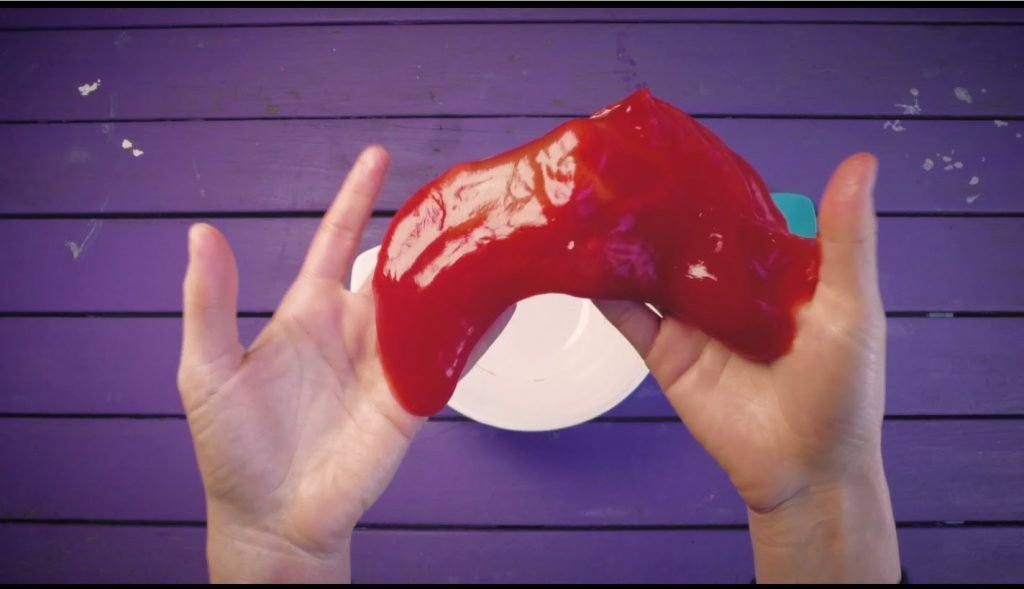 Close of of a person's hands holding the slime sensory activity
