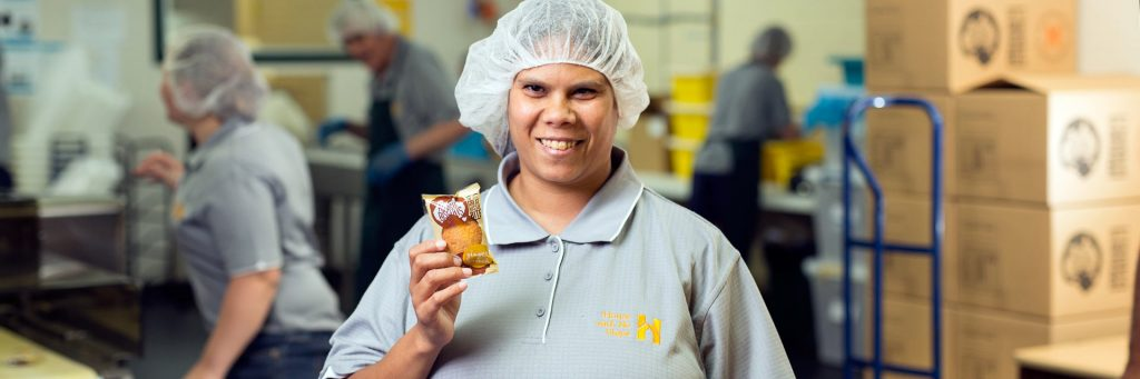 Lady with a disability working in the Aussie Biscuits business
