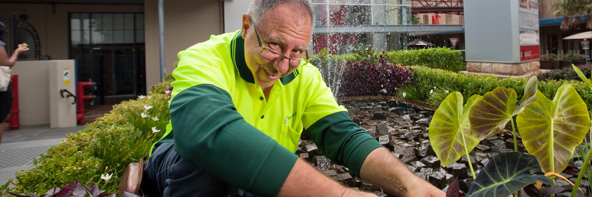 Man with a disability working in commercial grounds maintenance