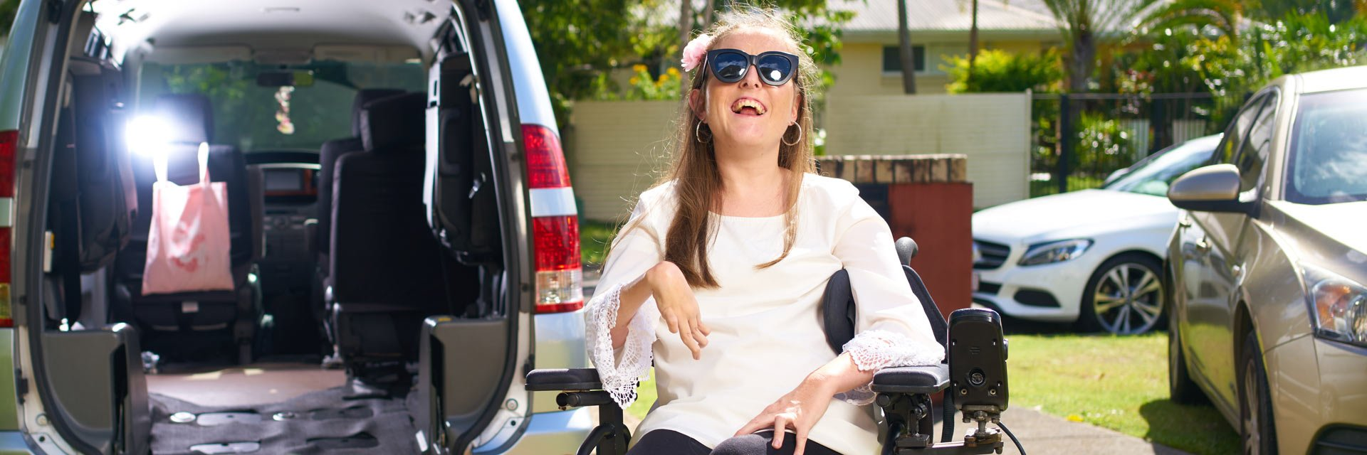 Customer outside the front of an accessible vehicle