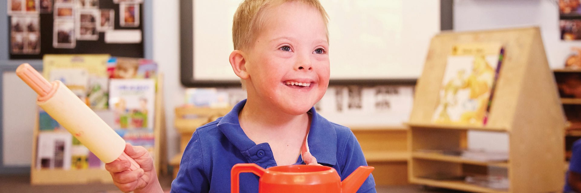 Boy with down syndrome in an early childhood intervention service
