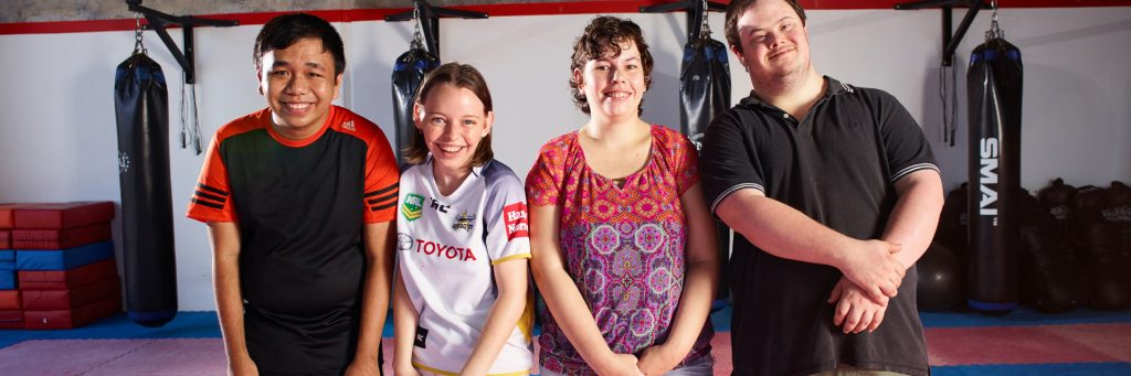 Four Aruma customers at the gym as part of their disability service