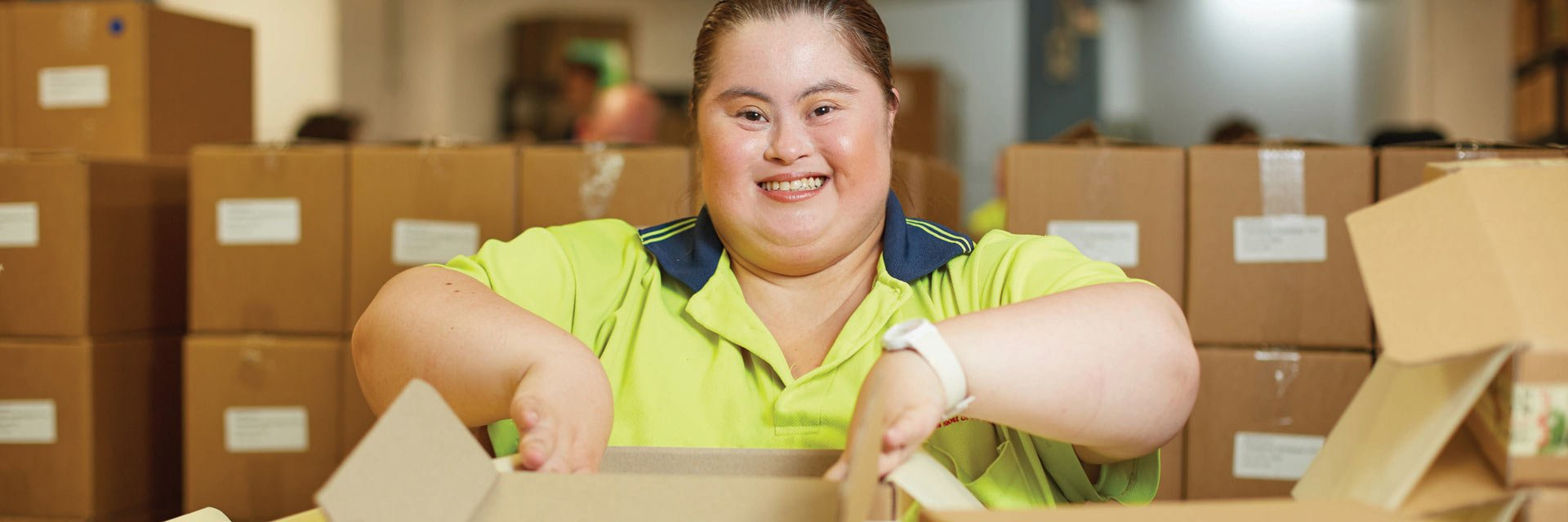 Lady with a disability working in the packaging business