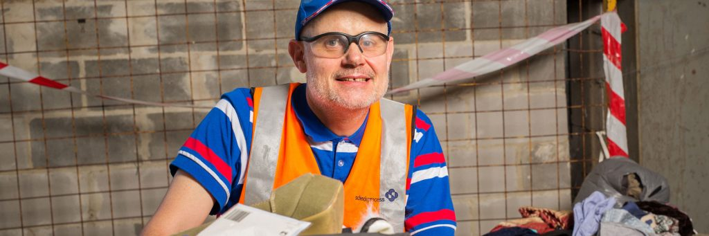 Man with a disability working in the recycling business