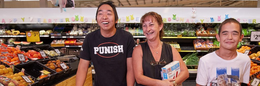 Disability Support Worker shopping with an Aruma customer