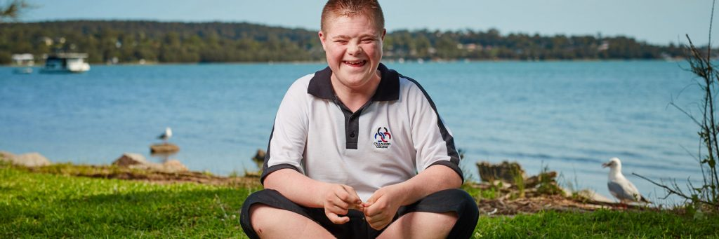 Young boy with Down syndrome in a short term accommodation and assistance service