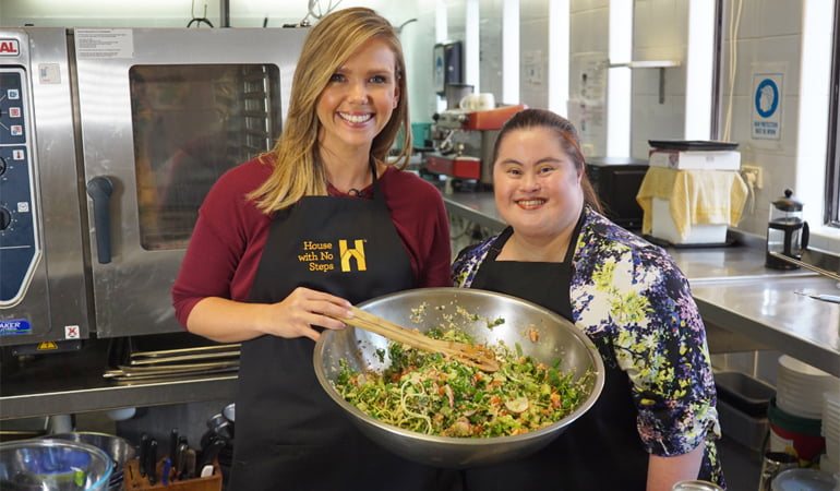 Susy and Edwina in the HWNS kitchen. HWNS provides employment for people with disabilities.