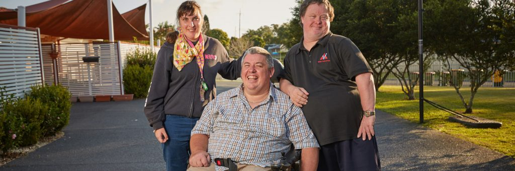 Three people with different types of disabilities