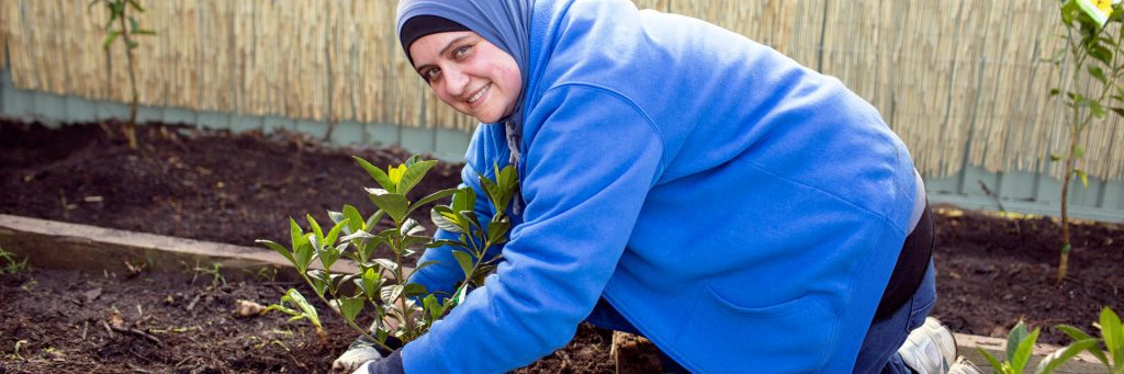 Volunteer gardening in an Aruma Disability Support Service