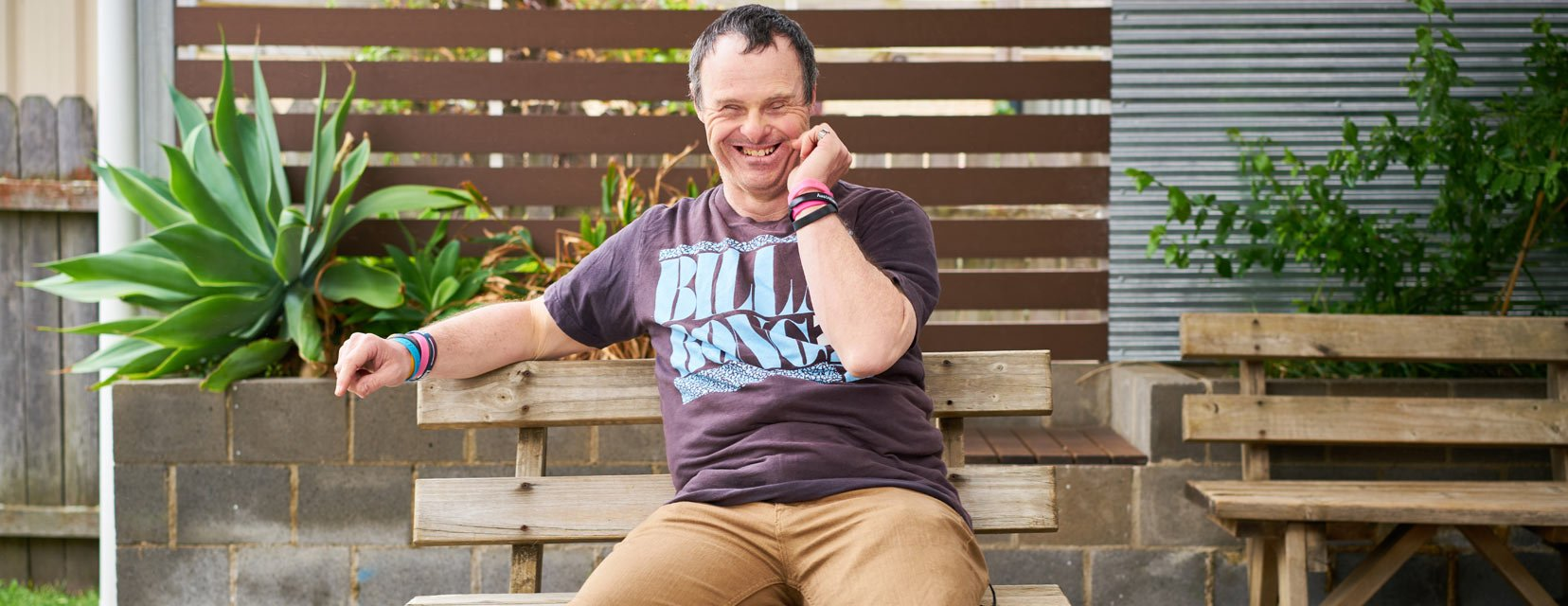 A House with No Steps NDIS customer sitting outside