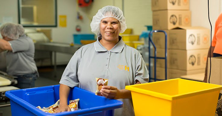 A Supported Employee from Aussie Biscuits working in the factory