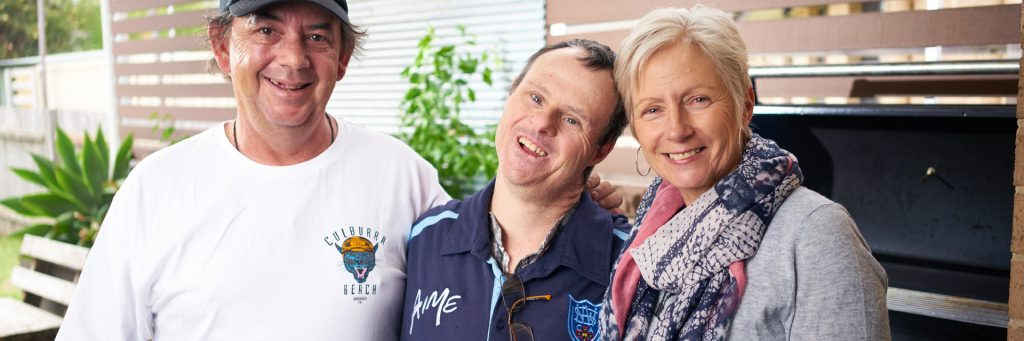 Two Aruma customers with a disability standing with their Disability Support Worker