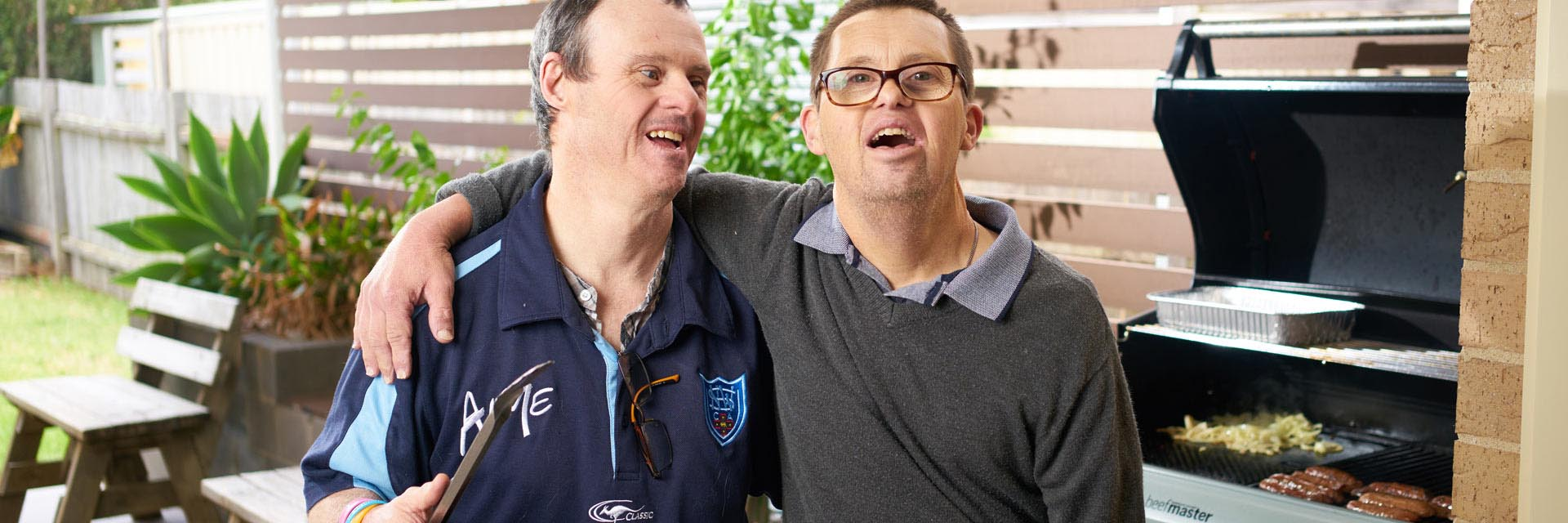 Two men with a disability laughing while at an Aruma disability service