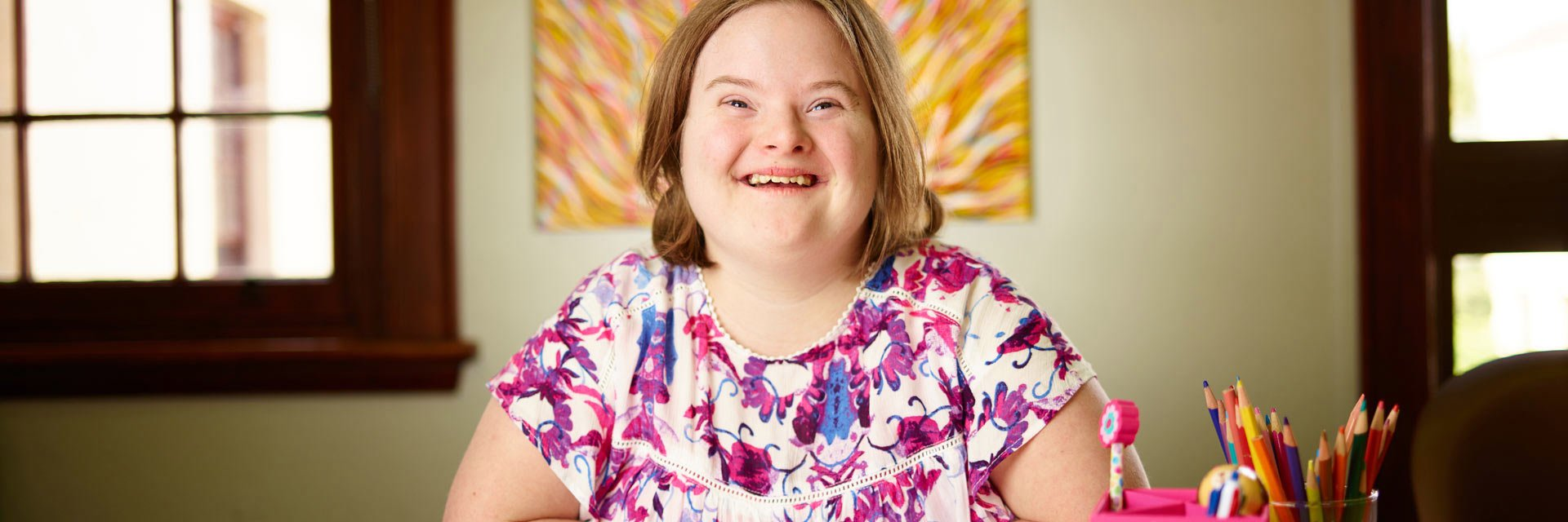 Woman with a disability in an office smiling