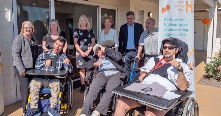 A group of Aruma customers and staff at the opening of Towns Avenue Supported Independent Living (SIL) accommodation