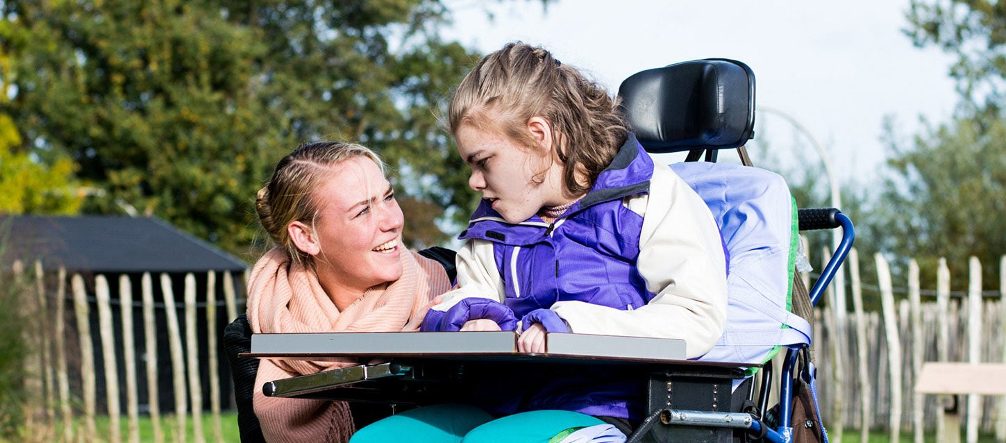 Young girl with a disability with her Disability Support Worker