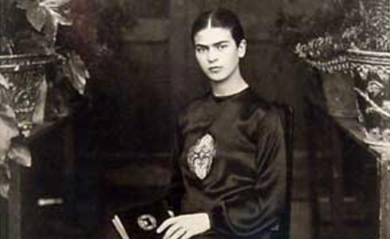 Frida Kahlo posing for a portrait in 1932