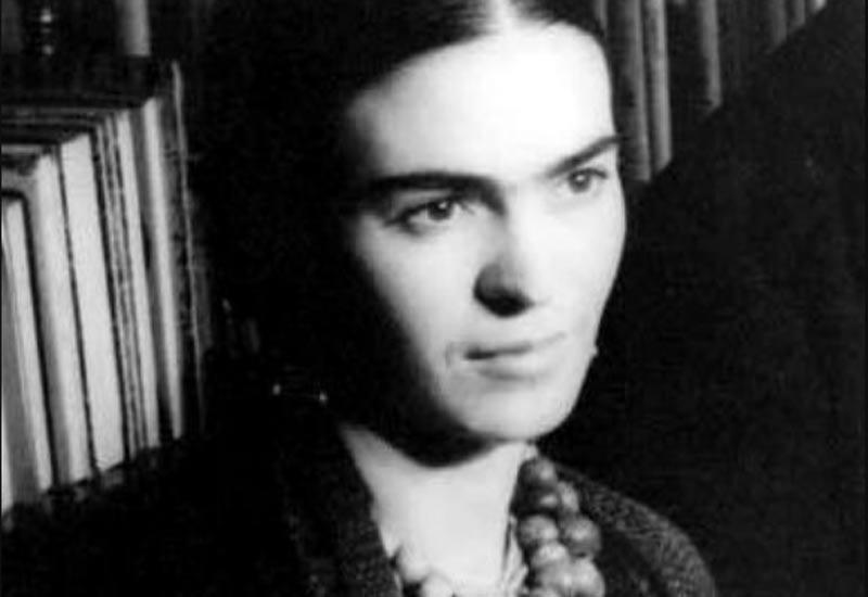 Frida Kahlo posing for a photo