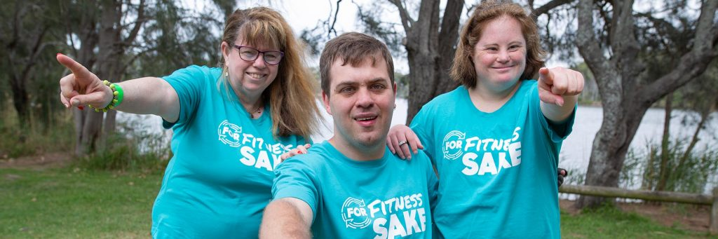 Three people with a disability wearing the For Fitness Sake t-shirt