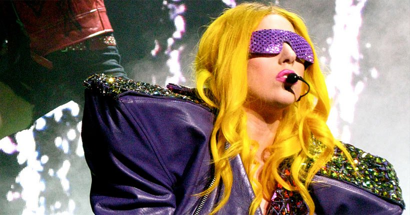 Lady Gaga wearing a costume and performing