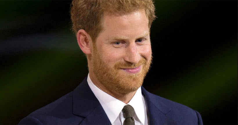 Prince Harry wearing a suit at an event
