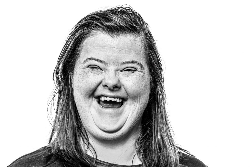 Woman with Down syndrome laughing