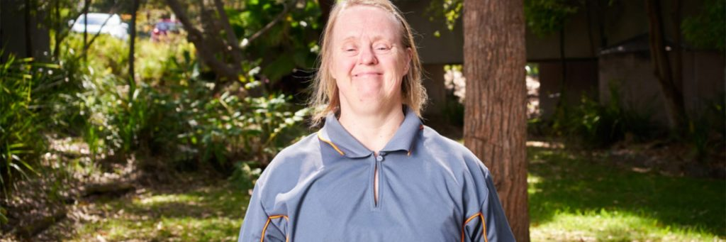 Woman with Down syndrome in her work uniform