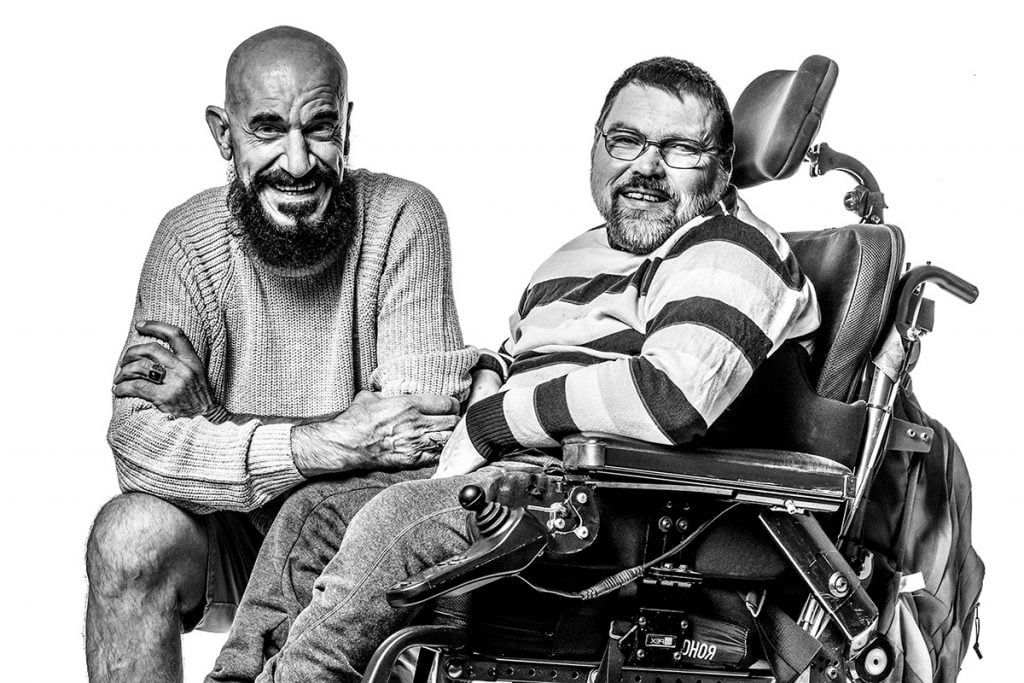 A customer with a disability who uses a wheelchair with his Support Worker