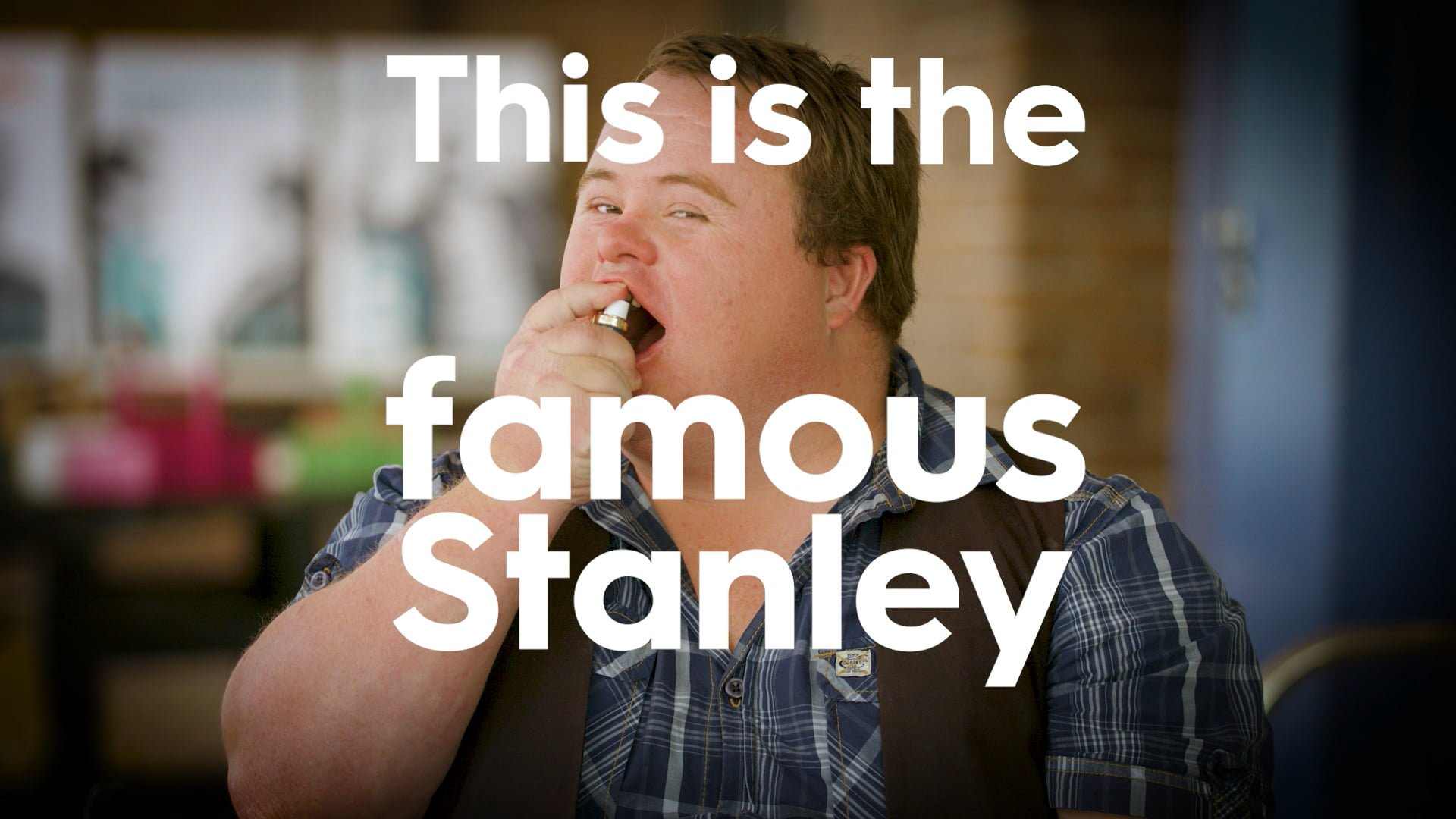 Stanley using a breath freshener with the words 'This is the famous Stanley' written over the top