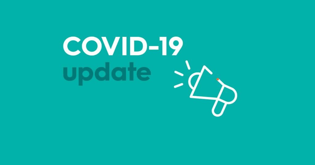 Text on a aqua background saying 'COVID-19 Update' with a picture of a megaphone