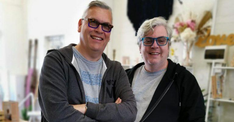 Derek and Stephen, wearing glasses and hoodies.