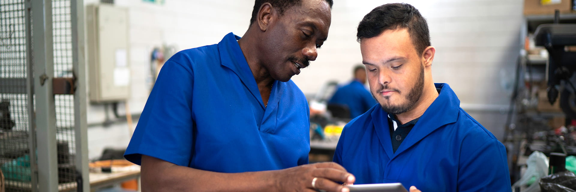 Supported Employee with a disability and his supervisor in the workplace